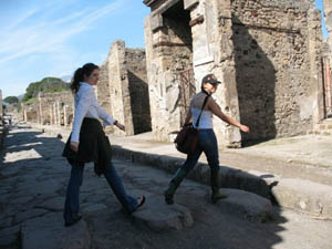 Walking across stepping stones in Pompeii